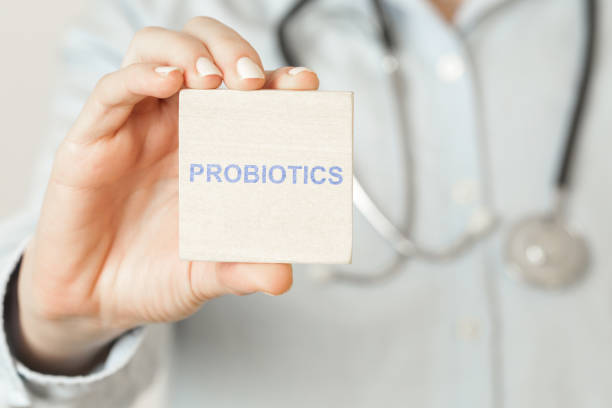 Doctor advises. Medical worker holds PROBIOTICS sign, healthy lifestyle concept. Doctor advises. Medical worker holds PROBIOTICS sign, healthy lifestyle concept. probiotic stock pictures, royalty-free photos & images
