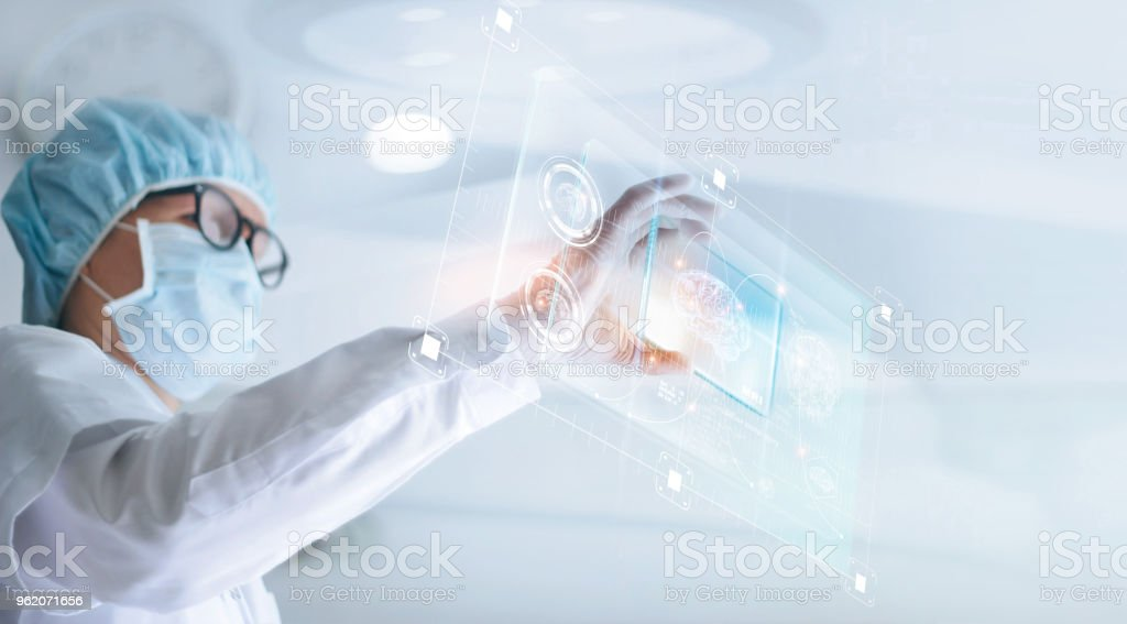 Doctor analyze and checking brain testing result with virtual computer interface, innovative technology in science and medicine concept stock photo