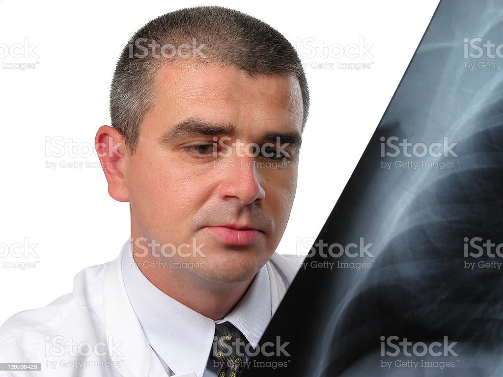 Doctor analyzing a chest radiography royalty-free stock photo