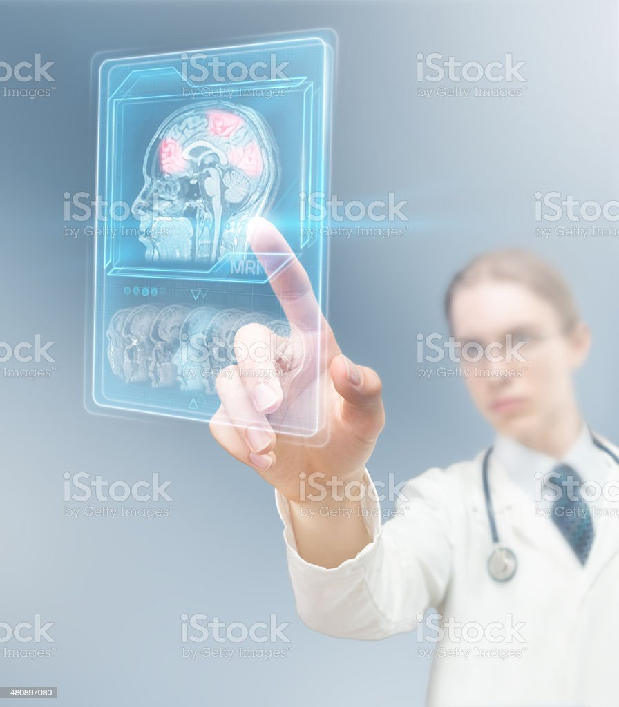 Doctor analyzing brain activity stock photo