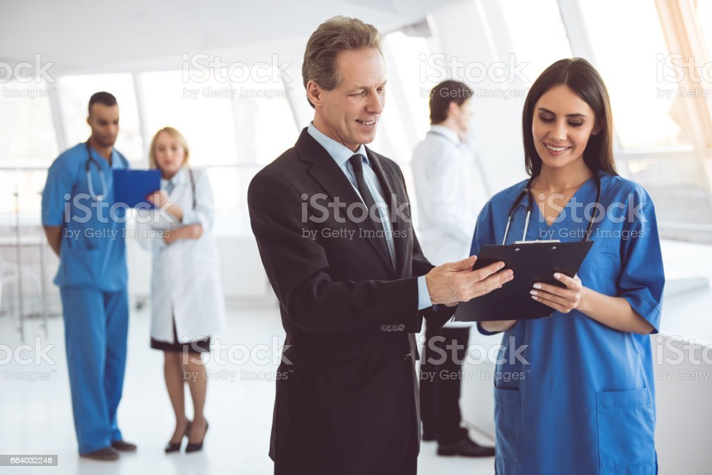 Doctor and businessman foto