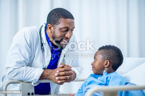 istock Doctor and child patient have a discussion in the hospital 1054016688