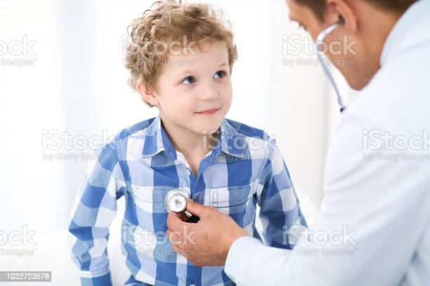 Doctor and child patient physician examines little boy by stethoscope picture id1022723576?b=1&k=6&m=1022723576&s=612x612&h=0o6pxp5 sdphn5 rvey g evccmlbbtwca1idl55smo=