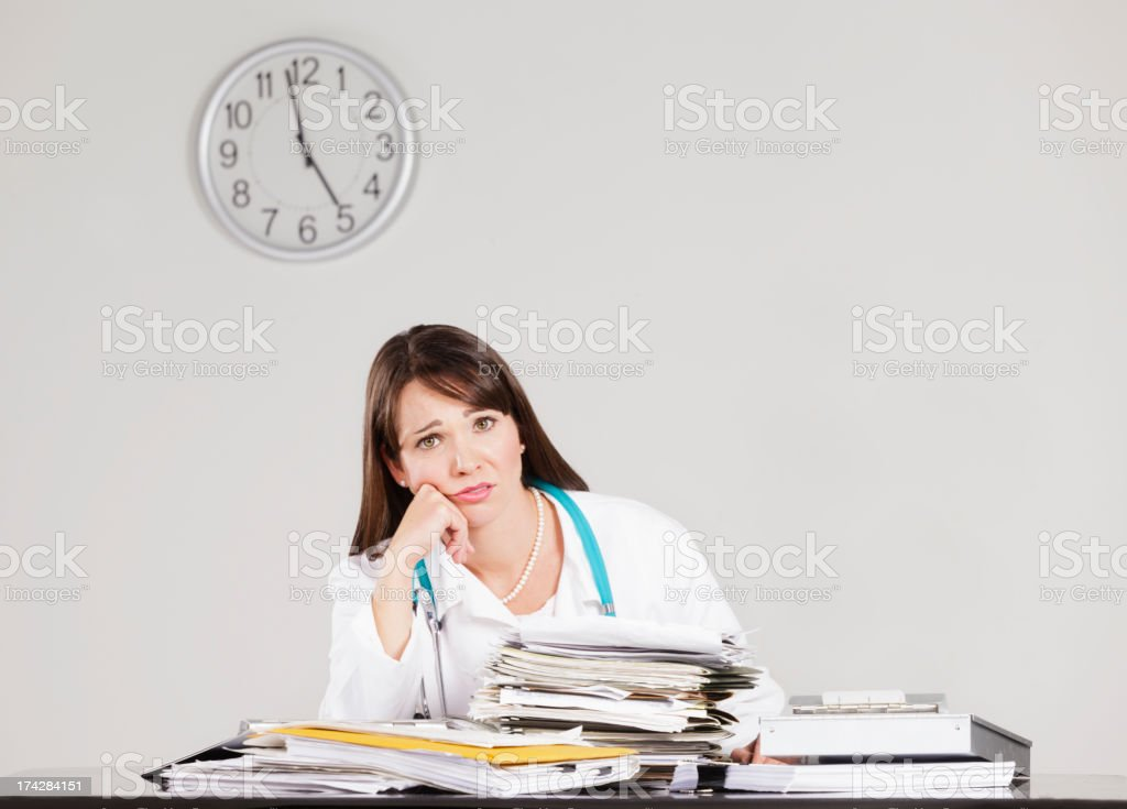 Doctor and Clock stock photo