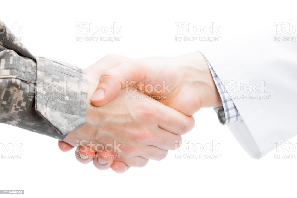 Doctor and military man shaking hands on white background - close up studio shot stock photo
