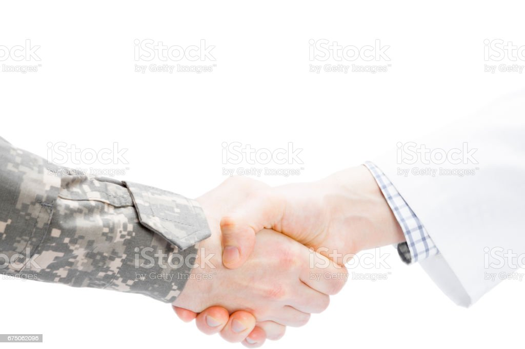 Doctor and military man shaking hands on white background stock photo