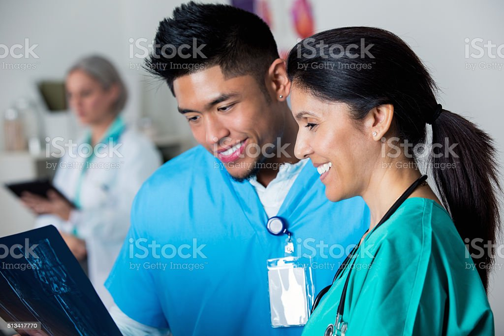 Doctor and nurse review patient x-ray stock photo