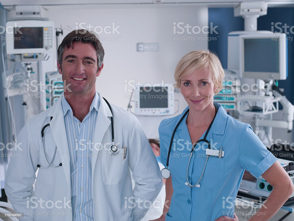 Doctor and nurse standing in intensive care royalty-free stock photo