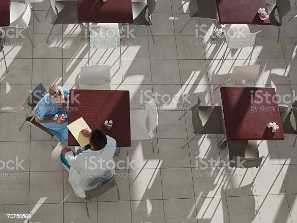 Doctor and nurse talking in cafeteria picture id170750569?b=1&k=6&m=170750569&s=612x612&h=wsfwkoxcxcyvjyw1bryyzf7hdlio7gaejalveqtah0g=