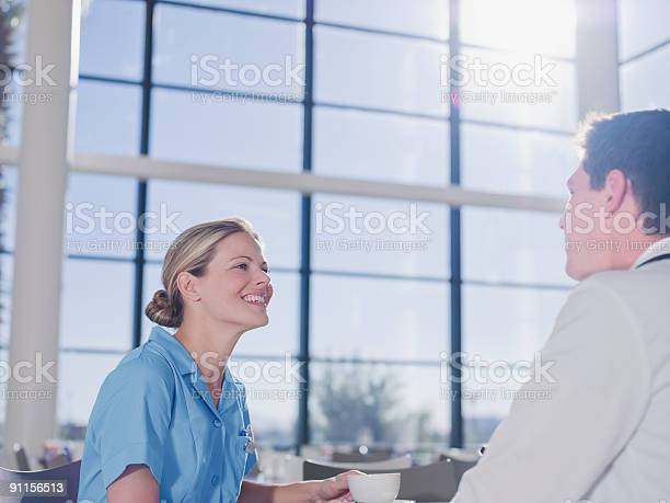 Doctor and nurse talking in cafeteria picture id91156513?b=1&k=6&m=91156513&s=612x612&h=oinshis3e9flfchj6dgdodeqzyzffdgwv2uikgw5jzu=