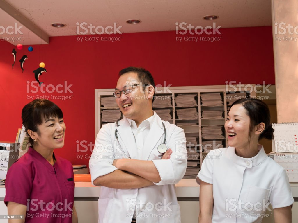 Doctor and nurses are having a good conversation. stock photo