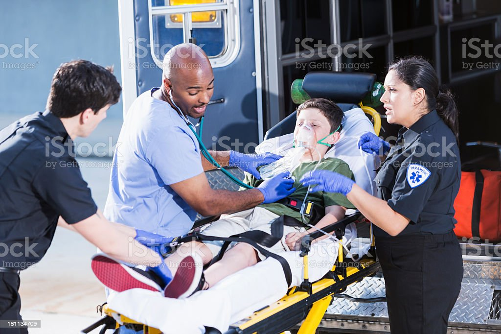 Doctor and paramedics helping child stock photo