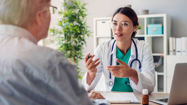 Doctor and patient are discussing at clinic stock photo