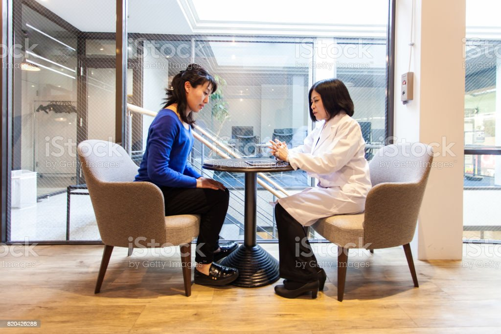 Doctor and patient at clinic stock photo