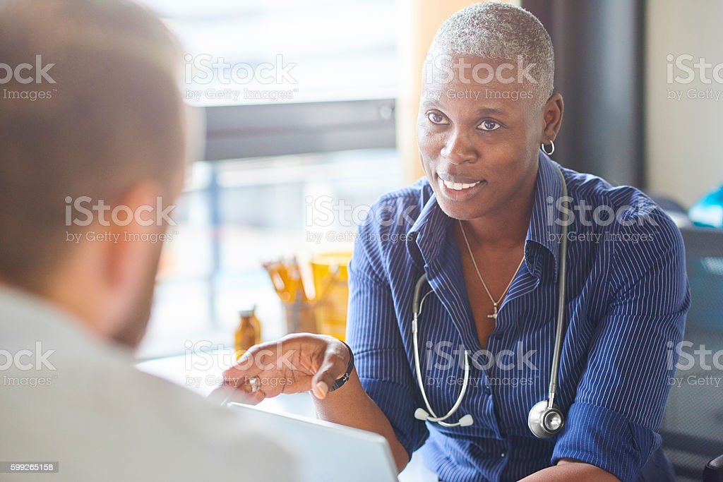 Doctor and patient chat stock photo