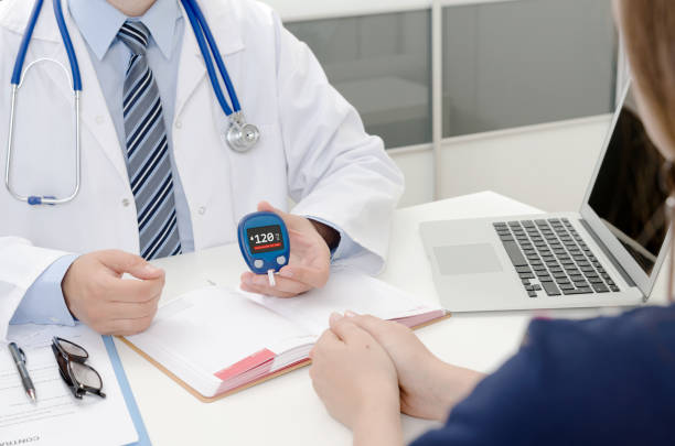 Doctor and patient diabetes consultation in office or clinic. – zdjęcie