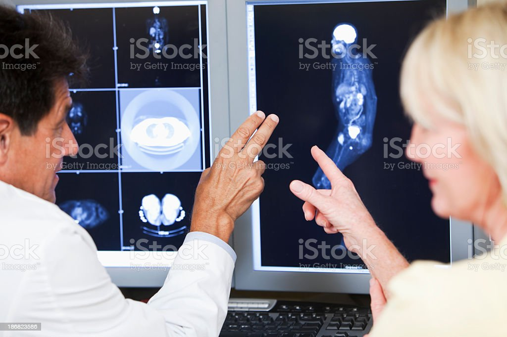 Doctor and patient discussing medical scans royalty-free stock photo
