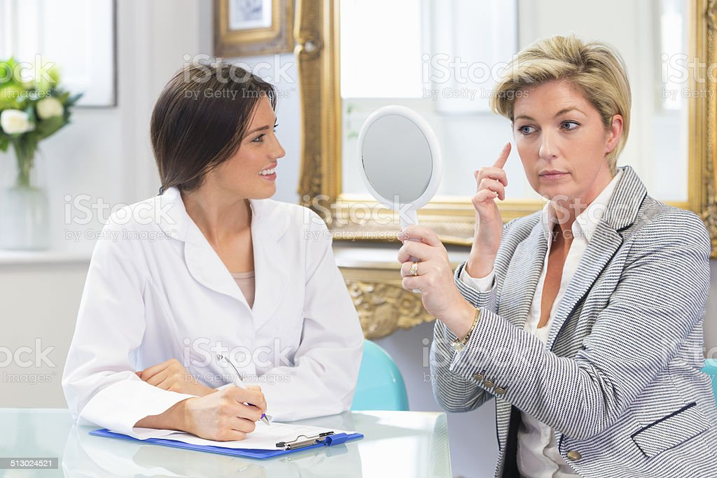 Doctor and Patient Discussion stock photo