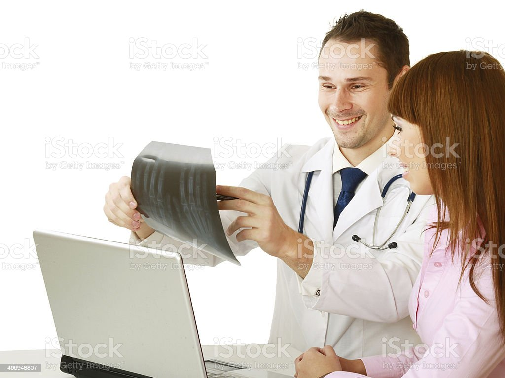 Doctor and patient examining x-ray royalty-free stock photo