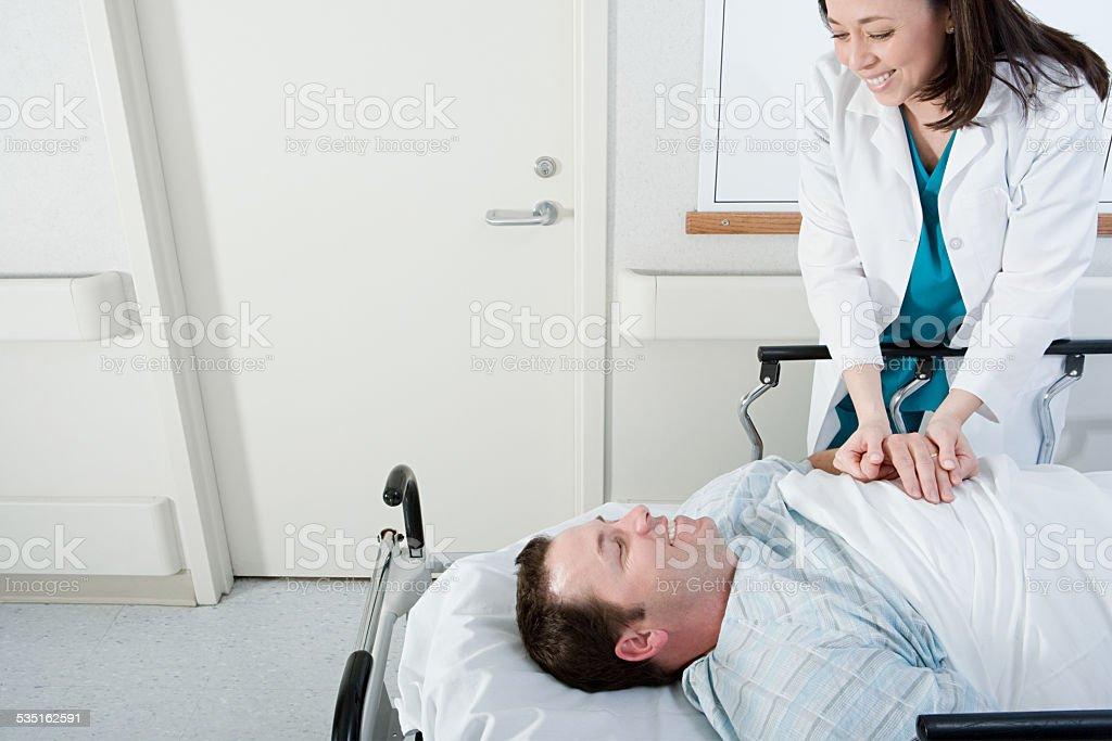Doctor and patient in corridor stock photo