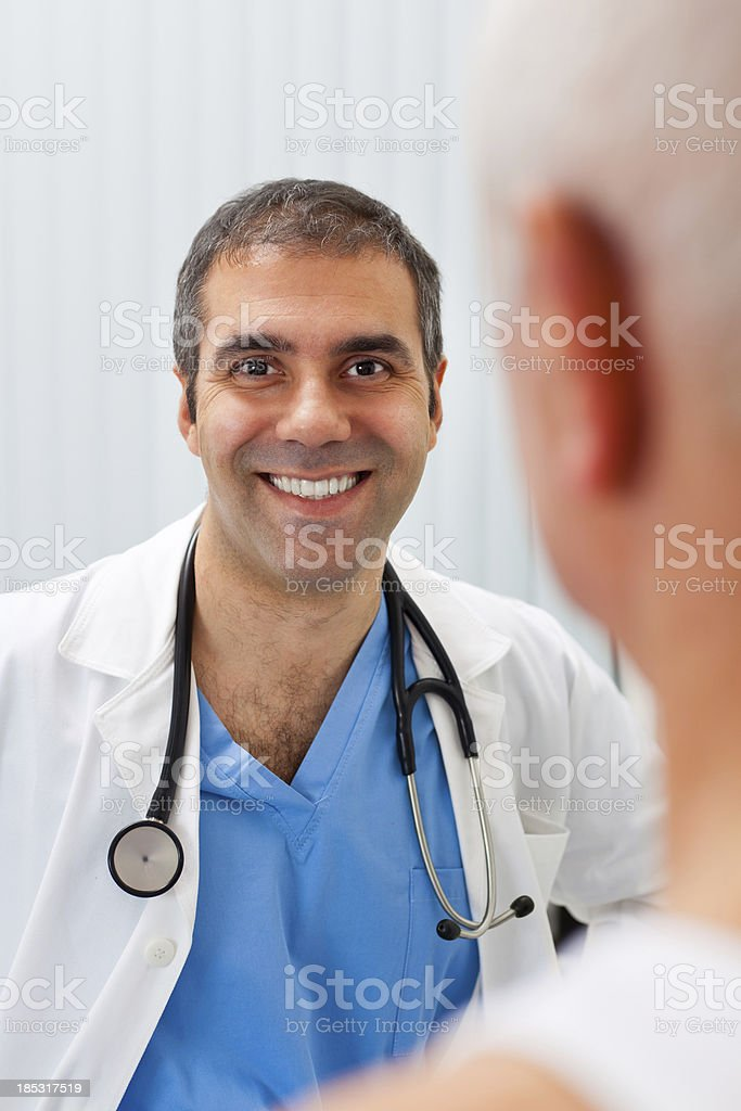 Doctor and patient in doctor's office royalty-free stock photo