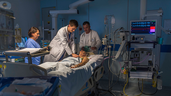 Doctor And Patient In Operating Theatre Stock Photo - Download Image Now