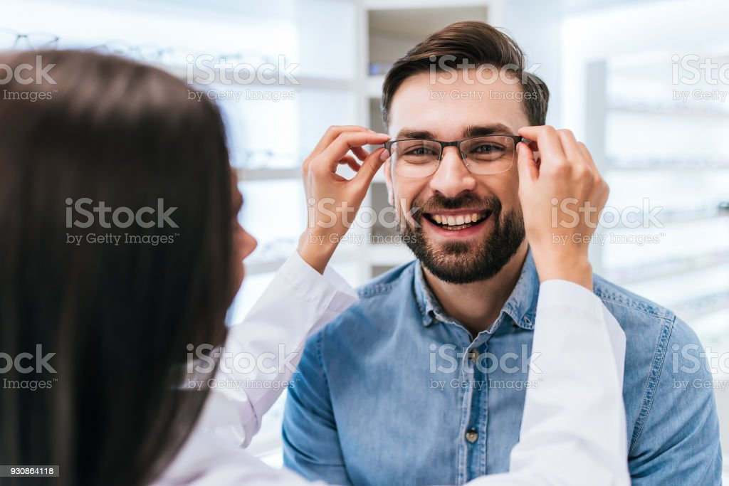 Doctor and patient in ophthalmology clinic stock photo