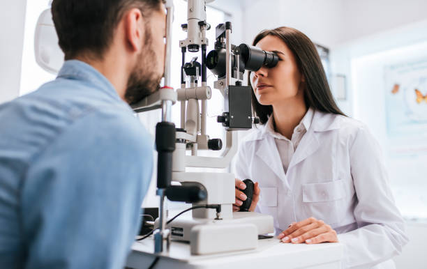 doctor and patient in ophthalmology clinic - optometrist stock pictures, royalty-free photos & images