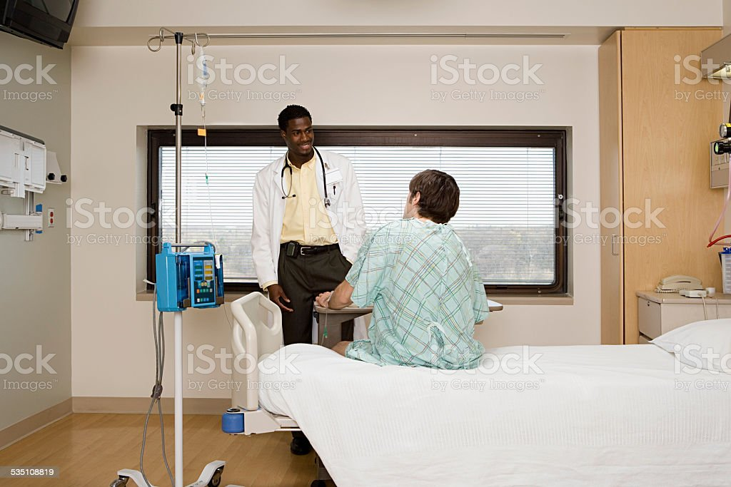 Doctor and patient in room stock photo