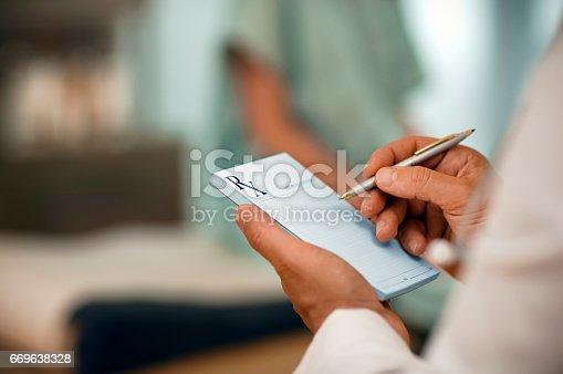 Doctor filling out RX prescription