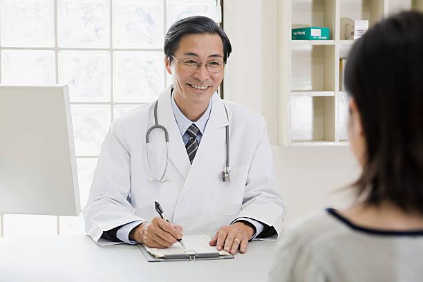 医者と患者 ストックフォト