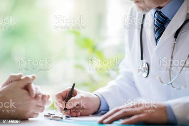 Doctor and patient taking notes in surgery picture id924365084?b=1&k=6&m=924365084&s=612x612&h= v oho2d89vtkjx6i7dujrtvh 86aj86mvufdzf wsa=