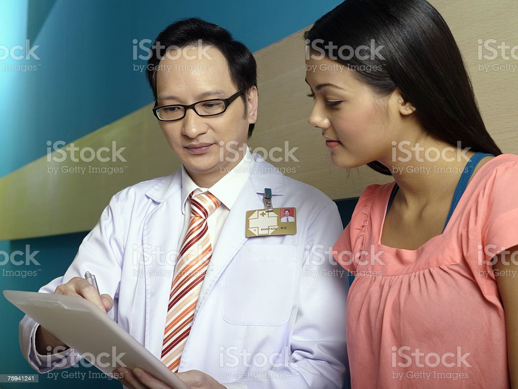 Doctor and patient talking royalty-free stock photo