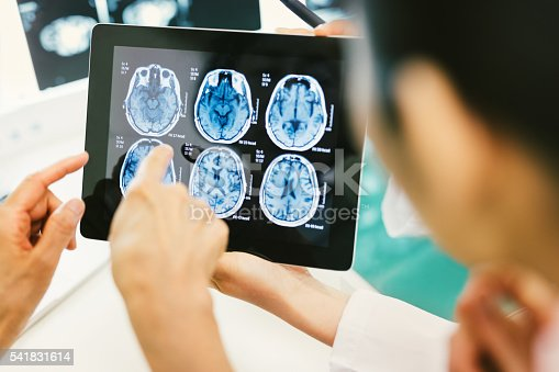 istock Doctor and patient using digital tablet in hospital 541831614