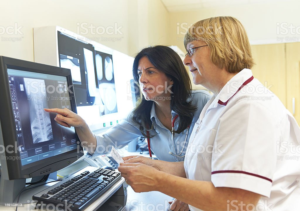 Doctor and Radiographer stock photo