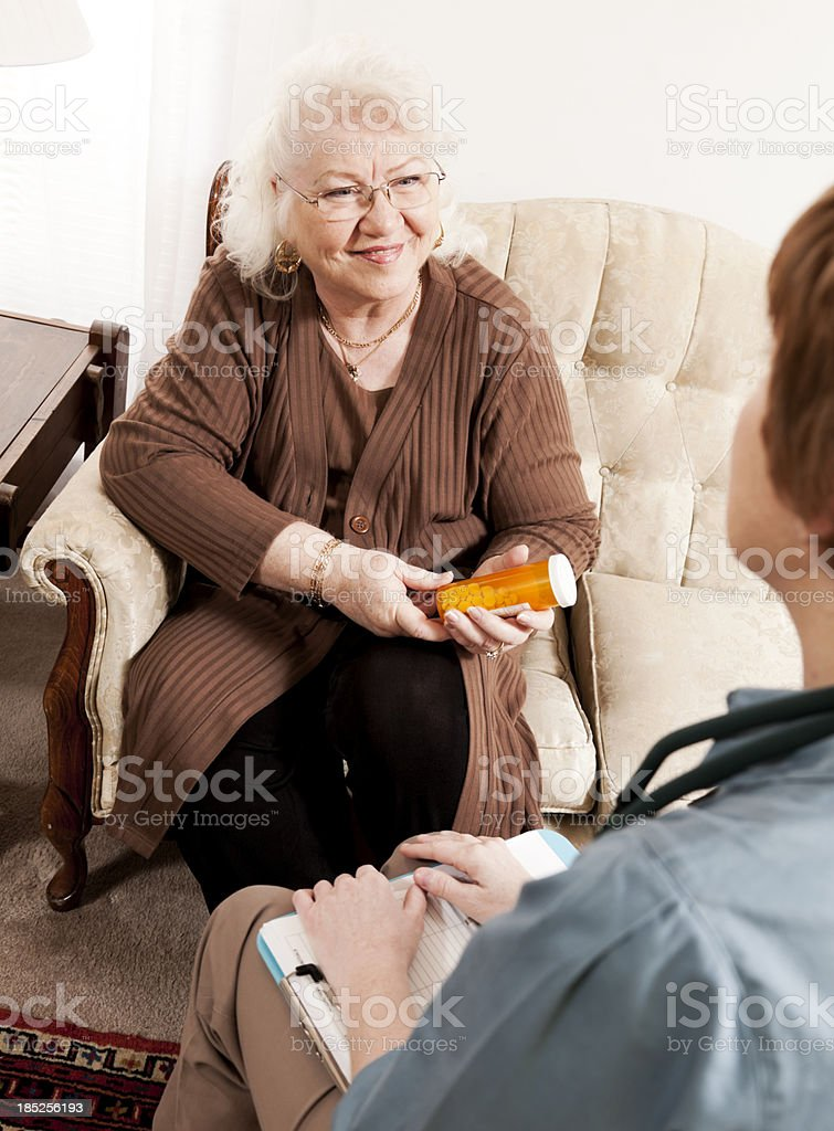 Doctor and Senior Discuss Medication royalty-free stock photo