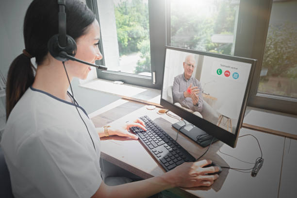 doctor and senior man patient, telehealth - telemedicine stock pictures, royalty-free photos & images