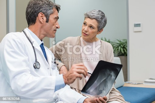 istock Doctor and senior patient 667825258