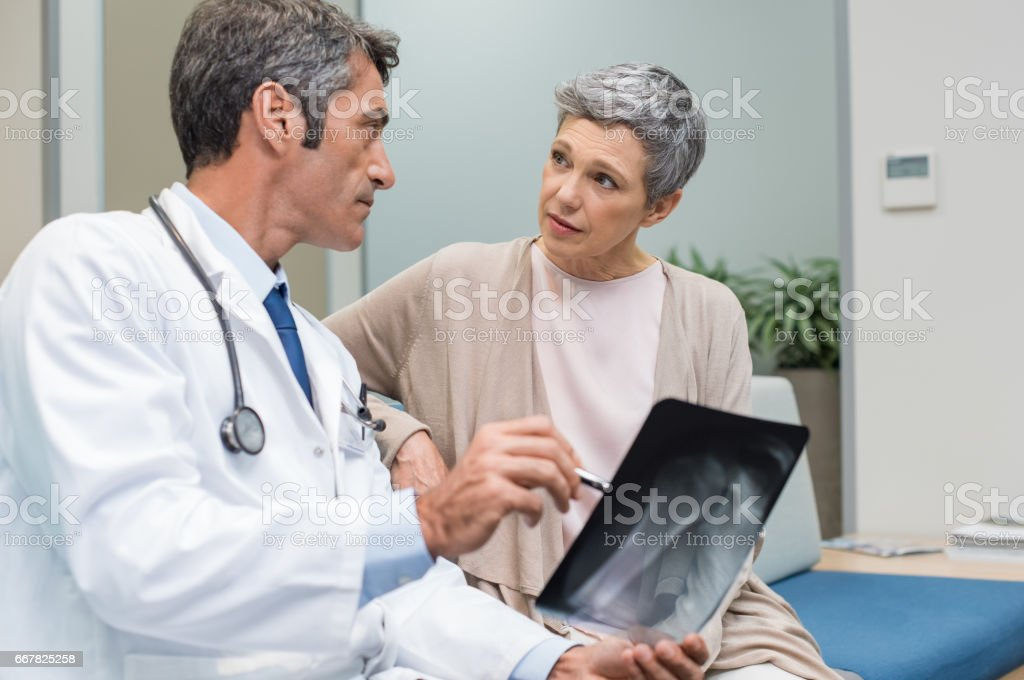 Doctor and senior patient stock photo