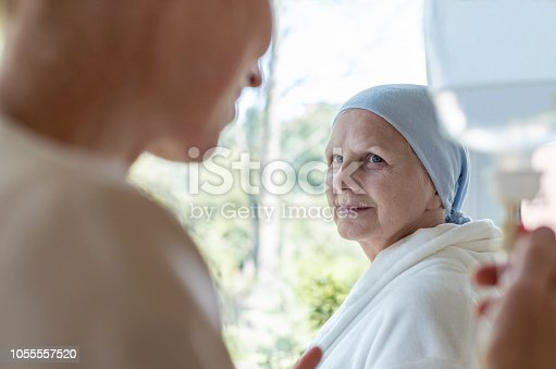928968772 istock photo Doctor and senior patient with terminal illness in hospital 1055557520