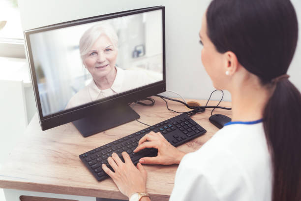doctor and senior woman patient, telehealth - telemedicine stock pictures, royalty-free photos & images