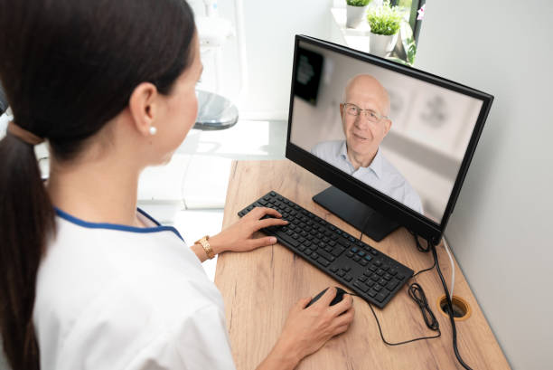 Doctor and senior woman patient, telehealth stock photo