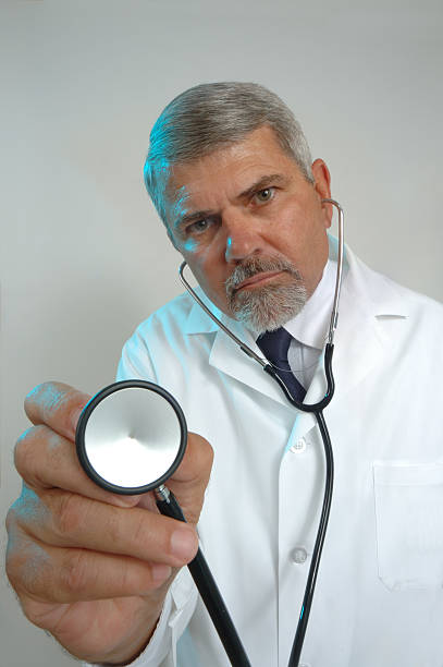 Doctor and Stethoscope During an Examination stock photo