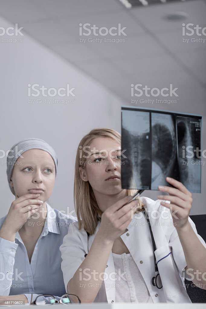 Doctor and test results stock photo