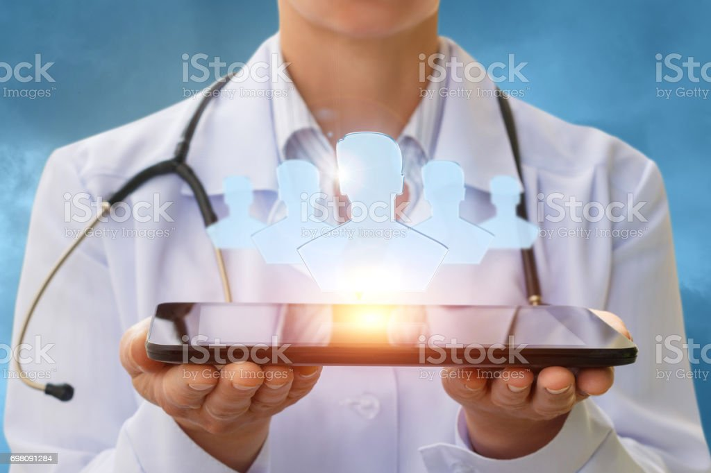 Doctor and the patients on the screen of the tablet. stock photo