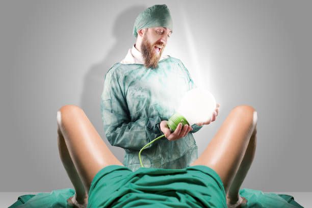 Doctor and woman legs giving birth to a light bulb - foto stock