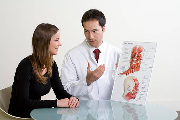 doctor and woman planning cosmetic surgery at consultation - medical diagrams stock pictures, royalty-free photos & images