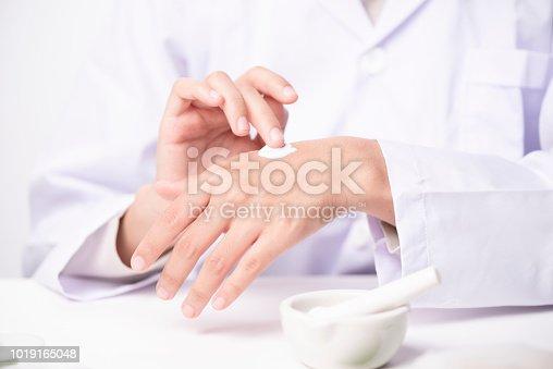 istock doctor applying hand cream 1019165048