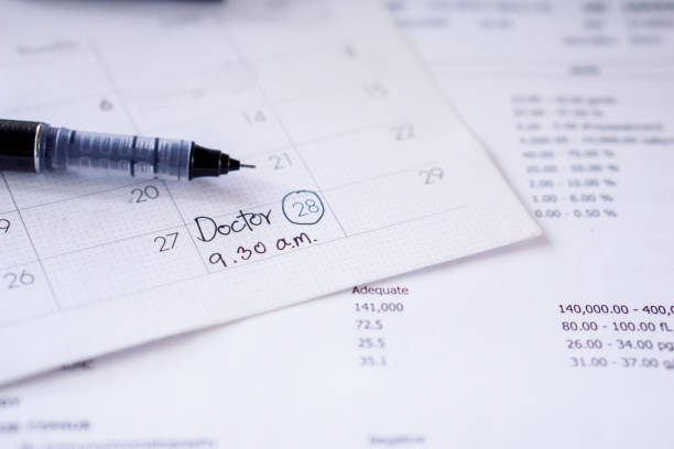 doctor appointment remind note on calendar with date and time stock photo