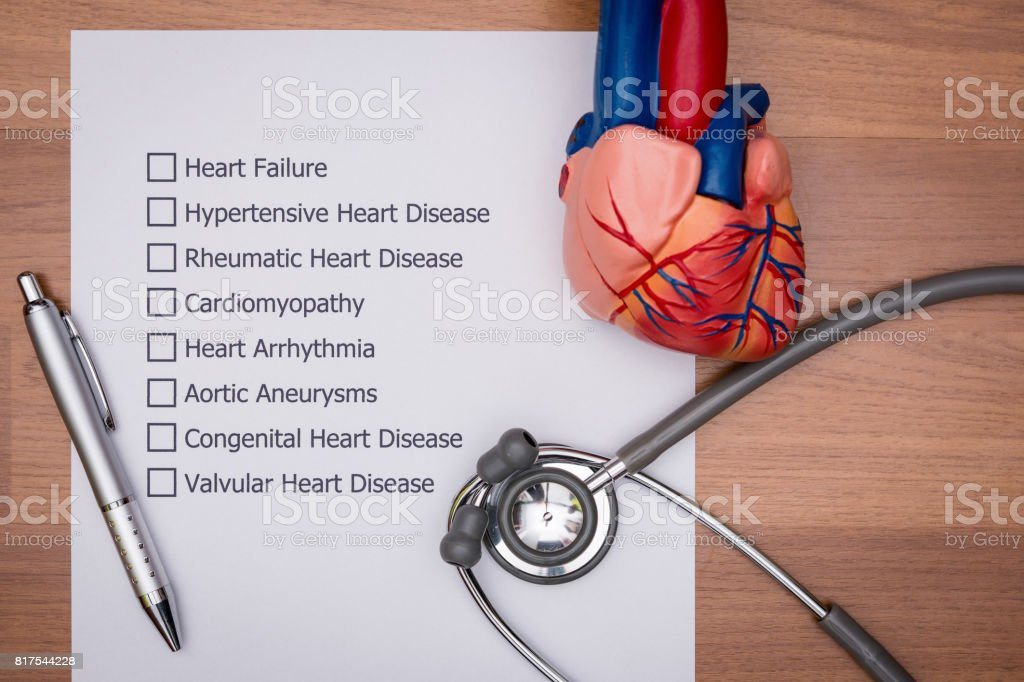 Doctor are diagnosing the disease in patient's heart. stock photo